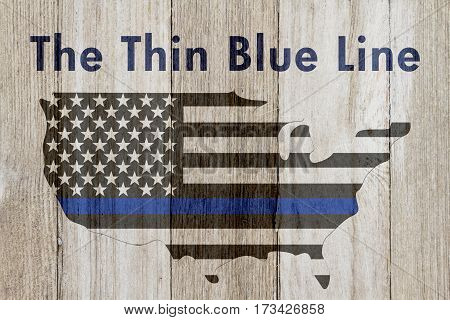 The thin blue line message USA thin blue line flag on a map on a weathered wood background with text The Thin Blue Line