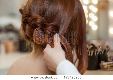 Beautiful, With Long, Red-haired Hairy Girl, Hairdresser Weaves A French Braid, Close-up In A Beauty