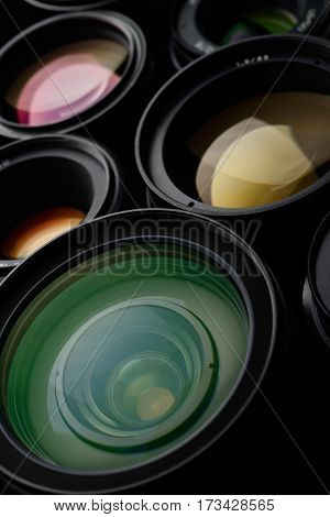 Lot of camera lens different sizes and colors