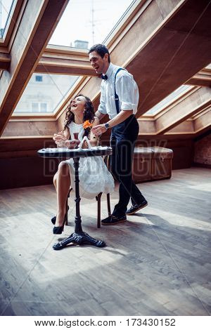 Happy romantic couple in love bonding in cafe
