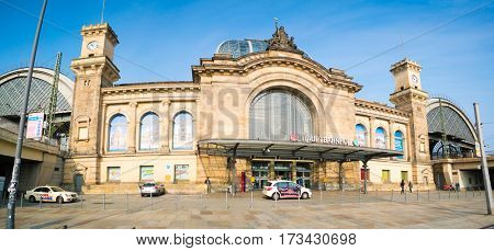DRESDEN, GERMANY - JUNE 20, 2016: Tourists at train station central station facade (Hauptbahnhof )