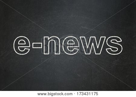 News concept: text E-news on Black chalkboard background
