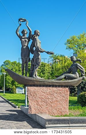 Dnipropetrovsk Ukraine - April 25 2014: Sculpture composition Youth of the Dnipro on embankment of Dnipro river in Dnepropetrovsk. The monument was opened in 2005