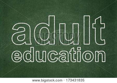Education concept: text Adult Education on Green chalkboard background
