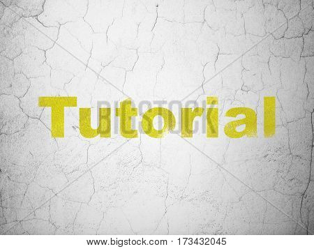 Education concept: Yellow Tutorial on textured concrete wall background