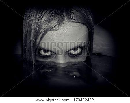 Portrait of evil mermaid, black and white