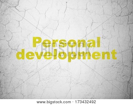 Studying concept: Yellow Personal Development on textured concrete wall background