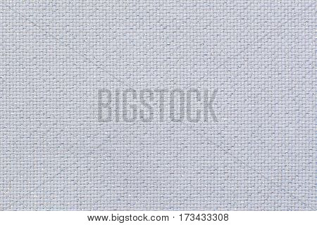 Natural white linen fabric with shining sparkles. Texture for the background