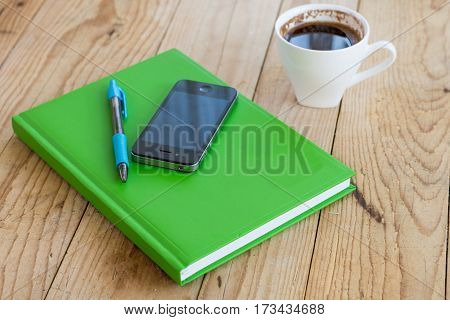 Business Notes With Pen Mobile Phone And Cup Of Coffee