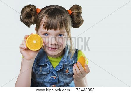 Baby girl blessed with a smile and orange on white background