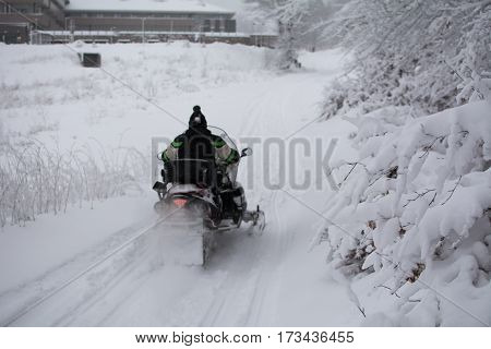 Man on snowmobile. Winter landscape on mountain Stara Planina, Serbia-Europe
