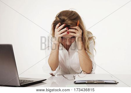 Young tired stressed and frustrated business woman desperate working at office with laptop