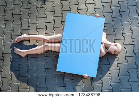 Young naked woman is lying on the road it is suicide.