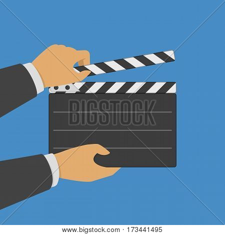 Black opened clapperboard in hands. Movie production clapper board. Cinematography concept. Vector illustration in modern flat style. EPS 10.