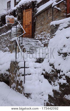 VELIKO TARNOVO BULGARIA - JANUARY 6 2016: Snowy steps of Rashov hotel in General Gurko street on the winter day