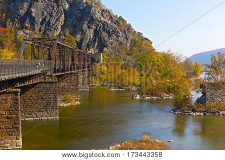 Appalachian trail crossing Shenandoah River in Harpers Ferry. Colorful autumn landscape from a scenic outlook in West Virginia USA.