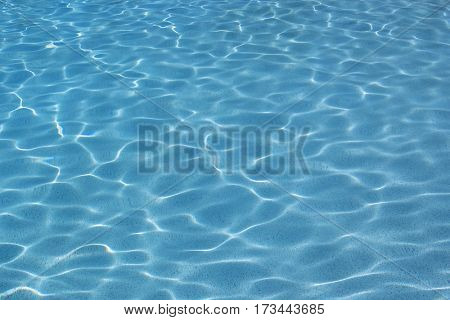 Swimming pool surface on a sunny summer day