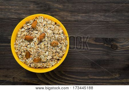 Oatmeal With Nuts   Almonds . Oatmeal On A Wooden Table. Oatmeal Top View. Healthy Food