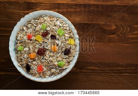 Oatmeal  With  Dried Fruit (strawberries, Grapes, Kiwi, Peach). Oatmeal On A Wooden Table. Oatmeal T