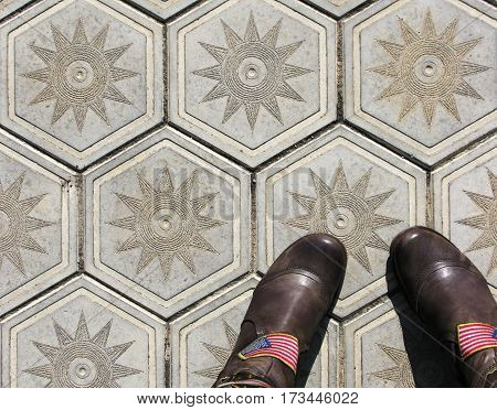 Boots shoes on the tile background outdoor photo