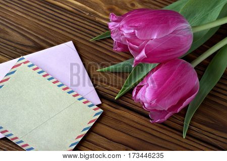 Beautiful Pink Tulips On Wooden Background With Envelop.copy Space.