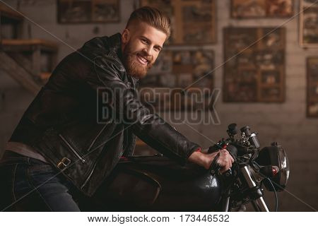 Guy In Motorbike Repair Shop