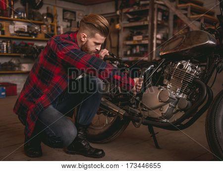 Guy In Motorbike Repair Shop