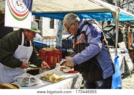 Belo Blato Serbia February 11.2017. Traditional Sausage Festival. Shopping hot peppers.