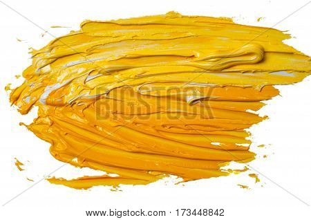 Artists oil paints. Abstract yellow splash and stain on a white background