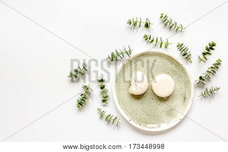 light woman breakfast with spring petals pattern on white table background top view