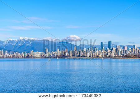 Fantastic view over ocean, yacht and snow mountains in Vancouver, Canada.