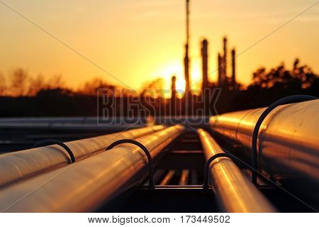 crude oil refinery during sunset with pipeline conection