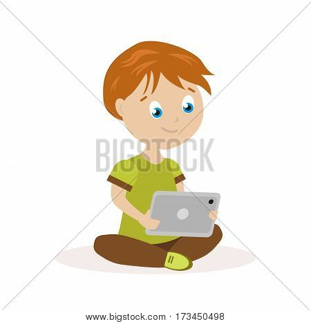 Boy sitting on the floor with a tablet in hands. The child reads or plays on an electronic device. Flat character isolated on white background. Vector, illustration EPS10