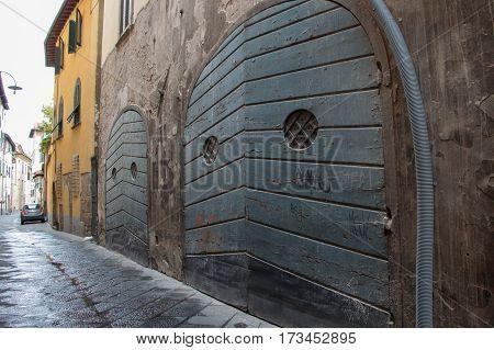 The view of ancient wooden door in old building.