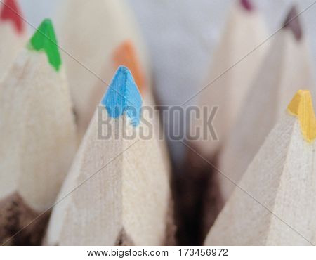 Sharp, bright colored pencils in a group.