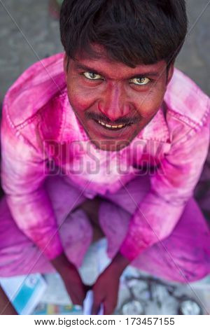 Vrindavan, India - March 23: Portrait of an unidentified man with face smeared with colors during Holi celebration in Vrindavan, Uttar Pradesh, India.