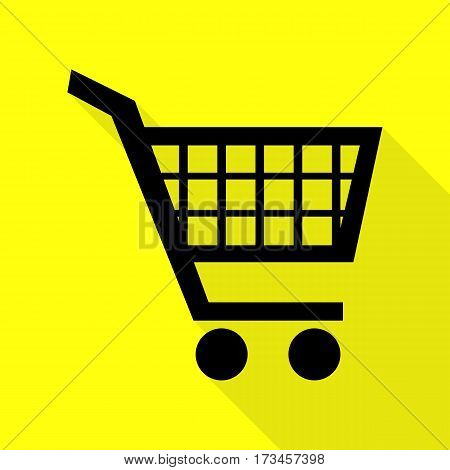 Shopping cart sign. Black icon with flat style shadow path on yellow background.