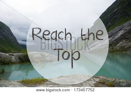English Text Reach The Top. Lake With Mountains In Norway. Cloudy Sky. Peaceful Scenery, Landscape With Rocks And Grass. Greeting Card