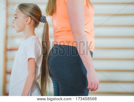 Children Differences in Weight and Size. Children in Gymnastic Room.