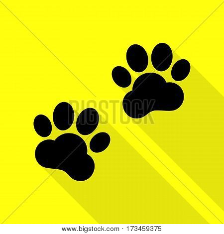 Animal Tracks sign. Black icon with flat style shadow path on yellow background.