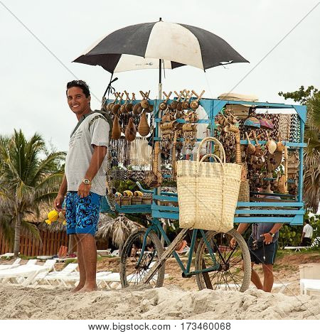 Varadero beach, Cuba - July 10, 2006. Beach vendor selling typical souvenirs on the beautiful Cuban beach of Varadero,