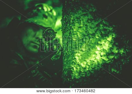 Hunting Poacher with Riffle in Night Vision Color Grading.