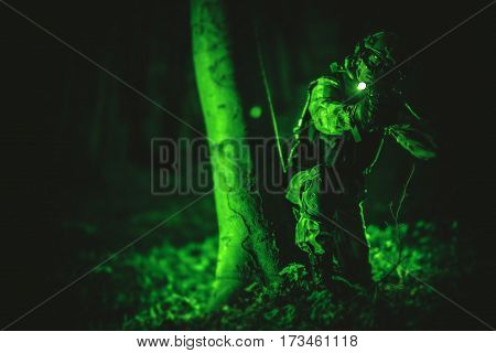 Soldier in Night Vision View. Military Concept Photo. Night Vision Color and Noise Grading.