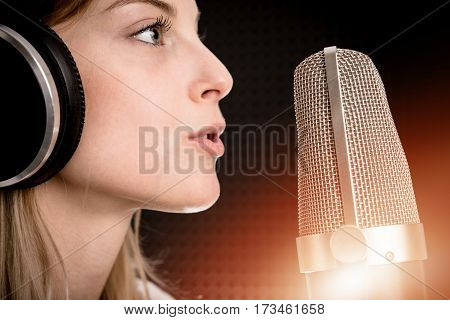Voice Recording and Radio Concept. Young Caucasian Woman Recording Voice in the Studio.