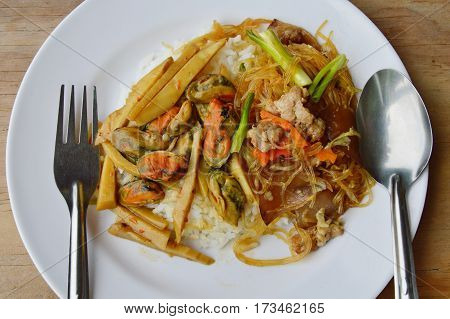 stir fried glass noodle and bamboo shoot with mussel on rice