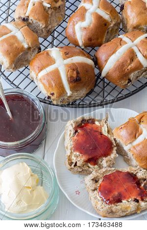 Hot Cross Buns from Above with Jam and Butter Vertical