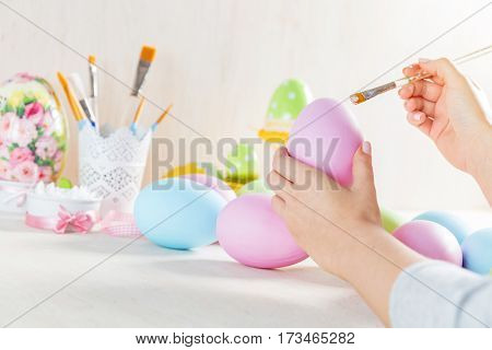 Easter egg painting in a workshop. Artistic hobby. Unique handmade decoration