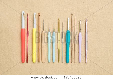 Crochet Needles Of Varying Sizes Arranged In A Row