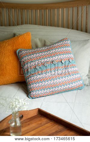 Throw Pillows And Wooden Tray With Blooms In Bed