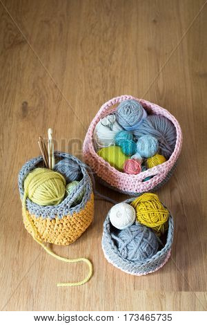 Needles And Balls Of Yarn In Knitted Baskets Copy Space